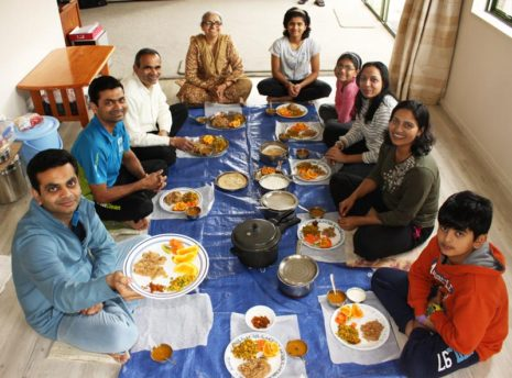 CrestClean franchisee Pinakin Patel (left) enjoying a family meal. Pinakin is sharing some of his family's favourite recipes.