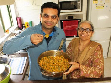 Pinakin Patel helping his mum Niruben in the kitchen.