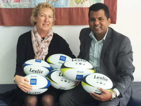Karen McMurray, winner of the rugby balls during the NZPF annual conference, receives her prize from Crest's Viky Narayan.