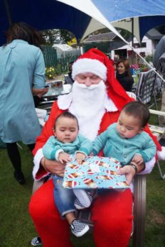 Kylar and Kyros Velez, twin boys who were born in January to Invercargill Crest franchisees Ronette and Karlo Velez, meet Santa.