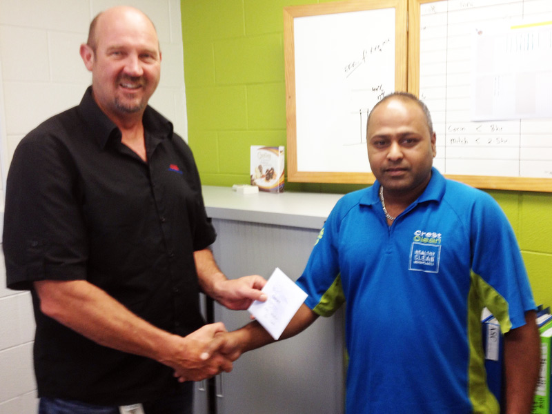 Gary Kirkland-Smith presents Dinesh Prasad with a $200 shopping voucher.