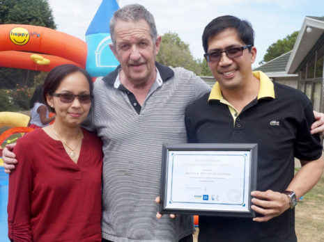 Martin and Maricel deGuzman receive their 3-year Certificate of Long Service Award from Glenn Cockroft.