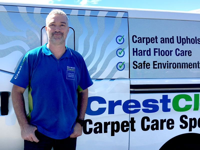 Carpet care expert Kent Wilkinson with his sign-written Nissan NV350 van.