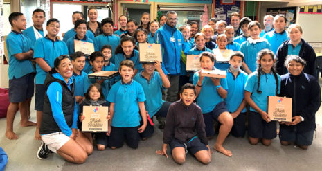 Pupils in Class Amua win the Cleanest Classroom Award at Red Hill Primary School, Auckland. Handing out the pizza prize is CrestClean's Mohammed Ashad.