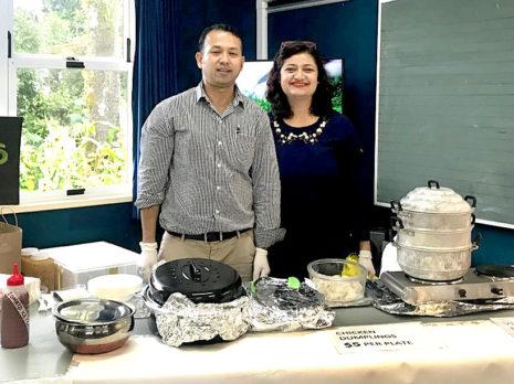 Prasun Acharya and his wife Diksha Niraula spent hours cooking dumplings for a school's fundraiser.