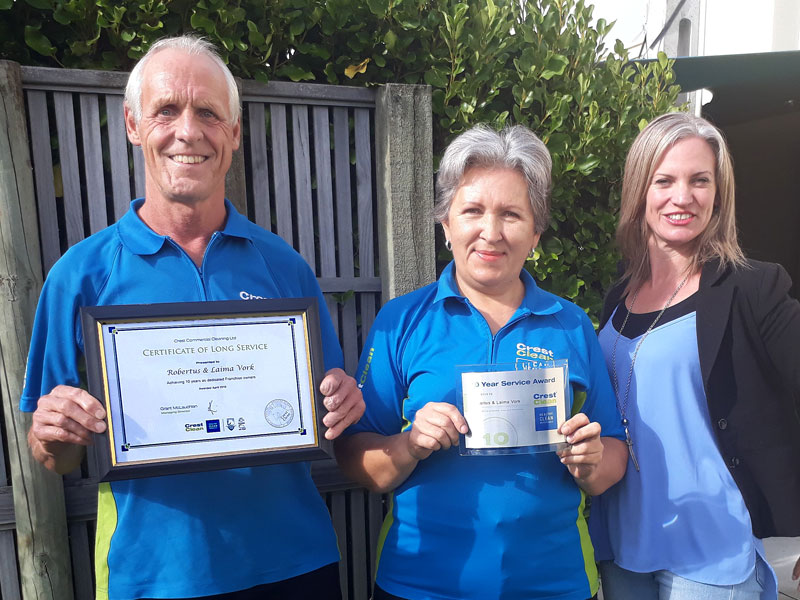 Robertus and Laima Vork receive their Certificate of Long Service from Aby Latu.