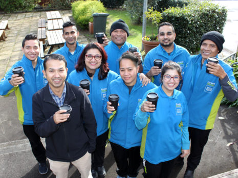 Taranaki Regional Manager Prasun Acharya with his team at one of their regular catch up meetings.