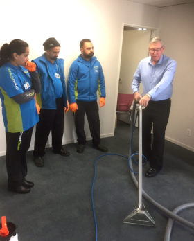 It's all hands-on as instructor Charlie Lodge demonstrates cleaning techniques.
