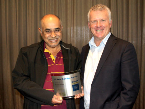 Rupendra Sharma receives his 15 Year Service Award from CrestClean's Grant McLauchlan.