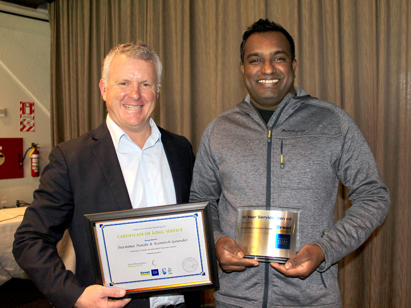 Kamlesh Gounder receives his Certificate of Long Service from Grant McLauchlan, CrestClean's Managing Director.