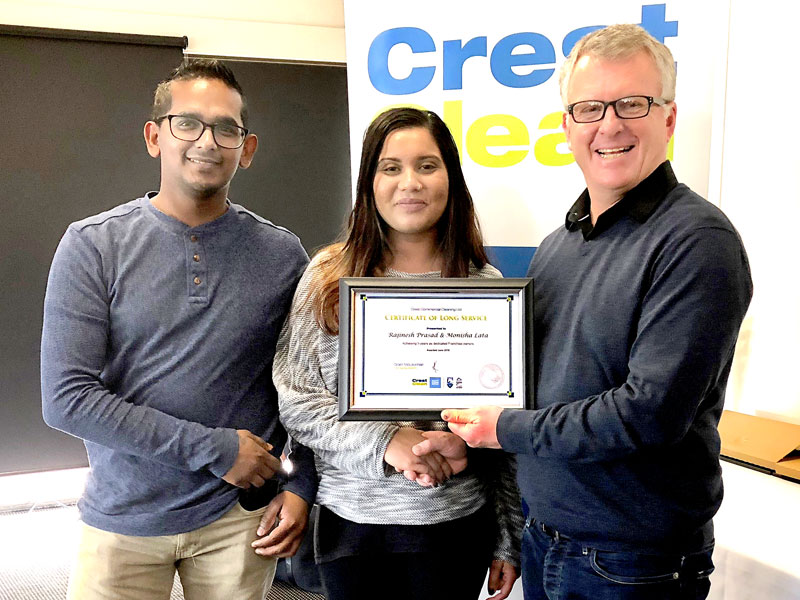 Rajinesh Prasad and Monisha Lata, who have been business owners for three years, receive their Certificate of Long Service from Grant McLauchlan, Crest's Managing Director.