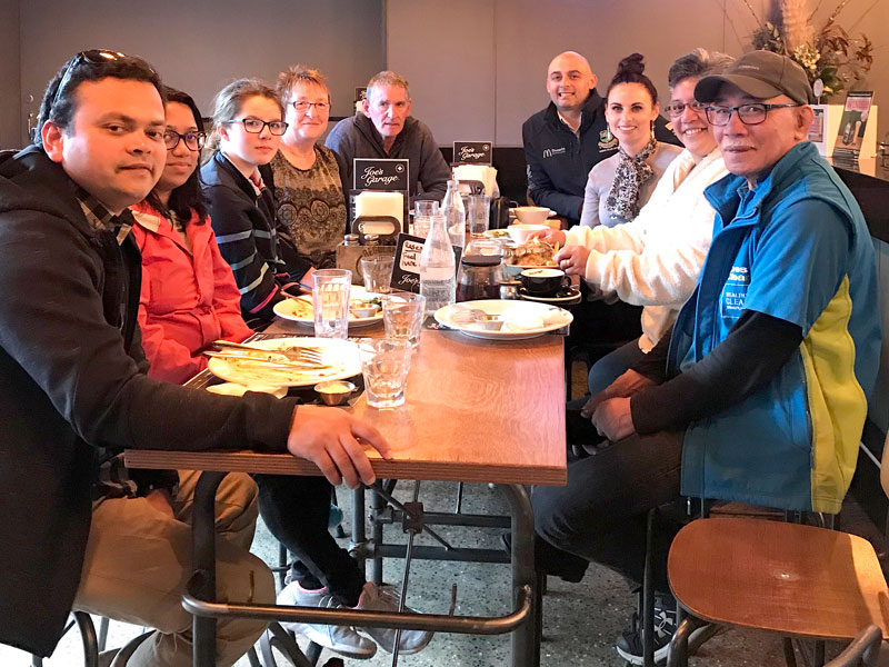 Owen and Carolyn Smithson (centre) with their CrestClean Dunedin collegues at a farewell lunch.