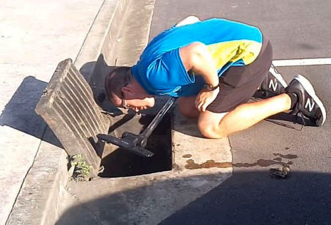Dominik checks the storm drain during the rescue.