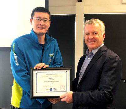 Wei Li receives his 7-year long service award from Grant McLauchlan, CrestClean's Managing Director.