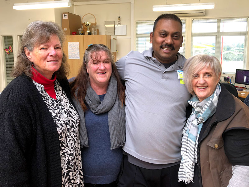Shalvin Raj with Don Buck School's Principal Jennice Murray (right) and admin staff Carolyn Goffin and Michelle Lewis.
