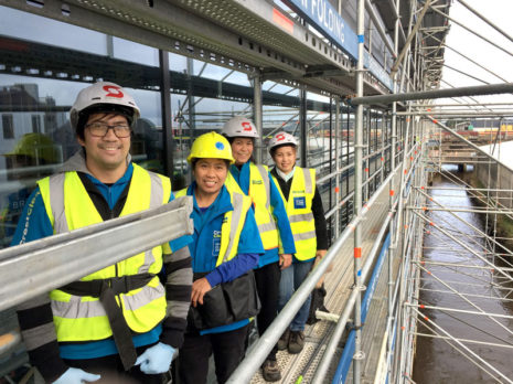 Martin DeGuzman, Marlene Madrid, Janeth Luna and Maricel DeGuzman cleaning windows on the new Kmart building.