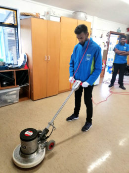 David Philips gets to grips with handling a floor polisher.