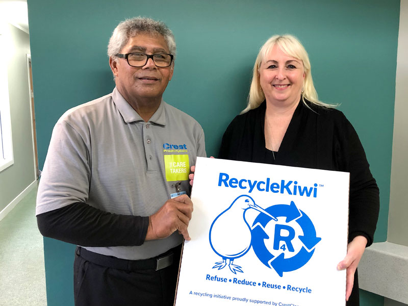 Principal Janet Moyle with caretaker Tagau Meleson seen presenting a RecycleKiwi resource pack.