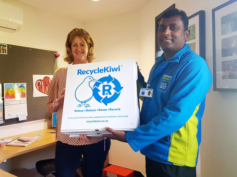 Naresh Mani presents a RecycleKiwi pack to Leanne Hanna, Principal's PA/Office Manager at Red Beach School.