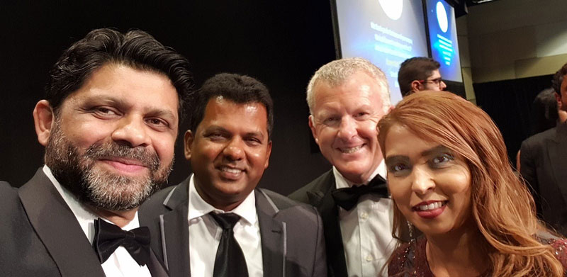 Fiji's Deputy Prime Minister and Attorney General Aiyaz Sayed-Khaiyum (left) congratulates Viky and Nileshna Narayan. Looking on is Grant McLauchlan, CrestClean's Managing Director.