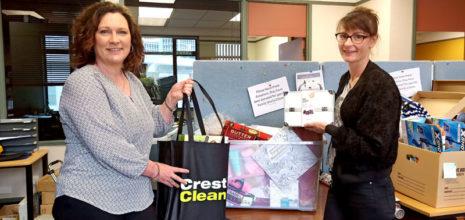 Rachael Hanna hands over the presents to Jasmin Enright of Presbyterian Support Otago.
