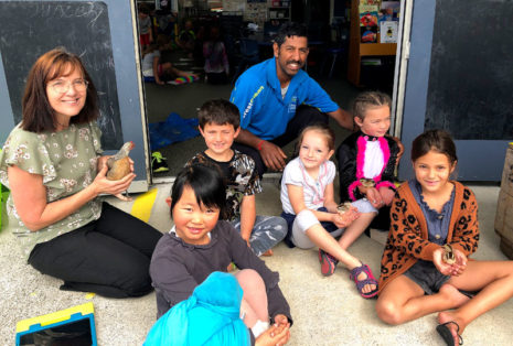 Salendra Chetty with teacher Suzie Gray and students at Maunu Primary School.