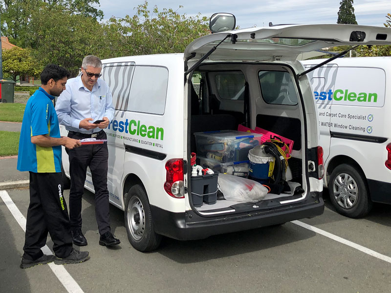 Sandeep Kumar has his van and equipment checked by Ian Noon, CrestClean's Health, Safety and Wellbeing leader.