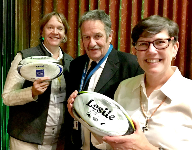 Glenn Cockroft presents CrestClean rugby balls to Sister Laurie Brink and Sister Betsy Pawlicki during their visit to Invercargill.