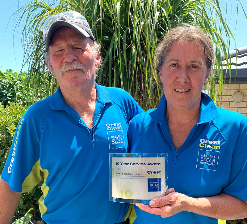 Stuart and Raylene Price with their long service award from CrestClean.