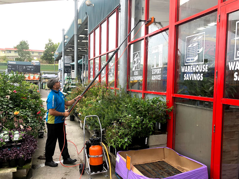 CrestClean business owner Tarun Kumar using the Pure Water Window system at Bunnings Warehouse.
