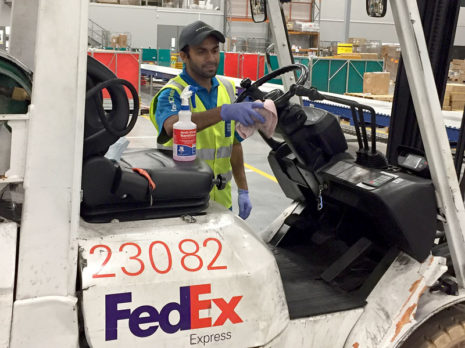 Ankush Bhandari carries out sanitising of a forklift truck cab at FedEx.