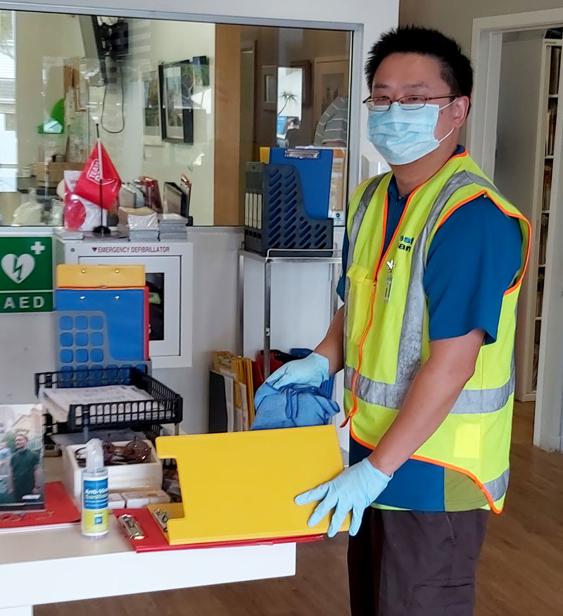 Wayne Ng carrying out a sanitising clean for New Zealand Blood Service in Auckland.