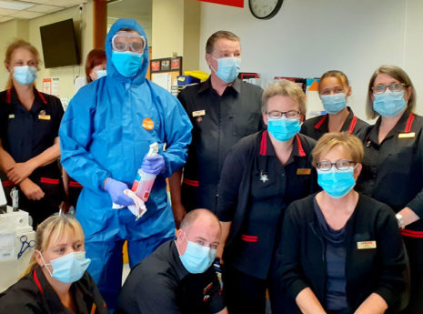 Lipson Varghese is seen in his full PPE for a photo with New Zealand Blood Service personnel at Palmerston North.