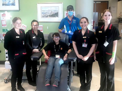 CrestClean's Dave Askin with staff at the New Zealand Blood Service in Wellington.