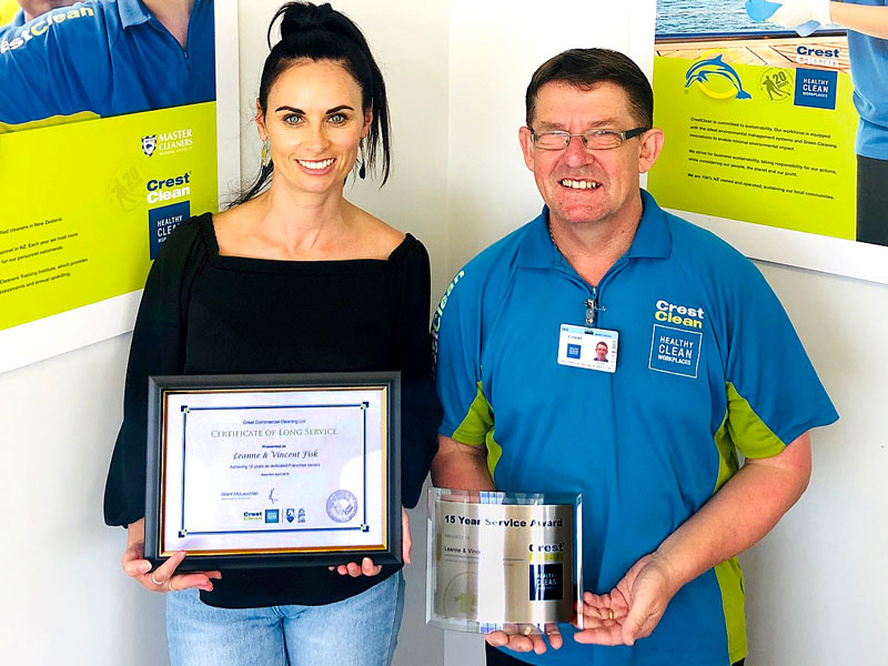 Vince Fisk receives his long service award from, Nicky Kramers, Regional Manager CrestClean Dunedin.
