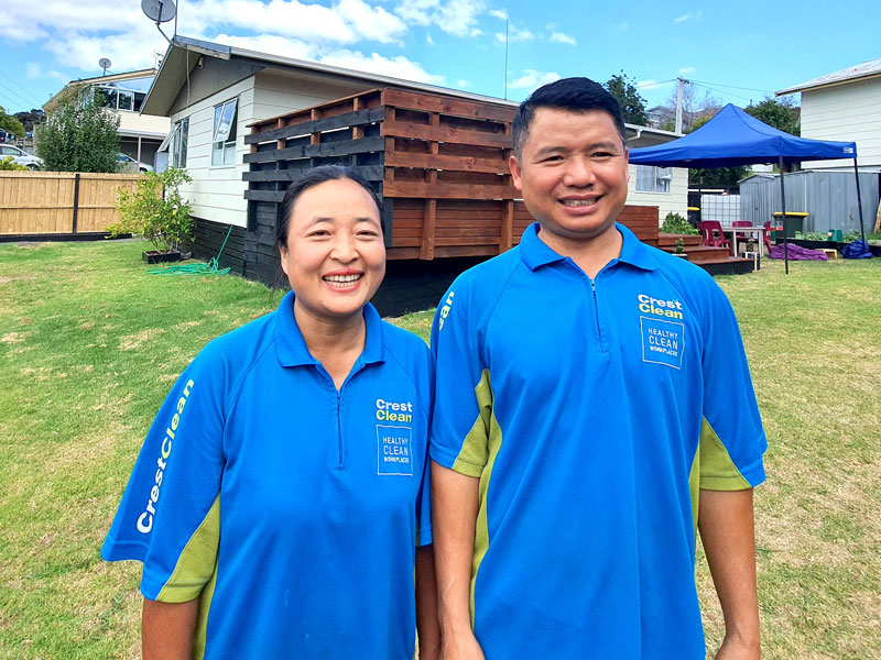 Thang Hlawnceu and his wife Van Par Hnem in the garden of their new home in the Auckland suburb of Massey.