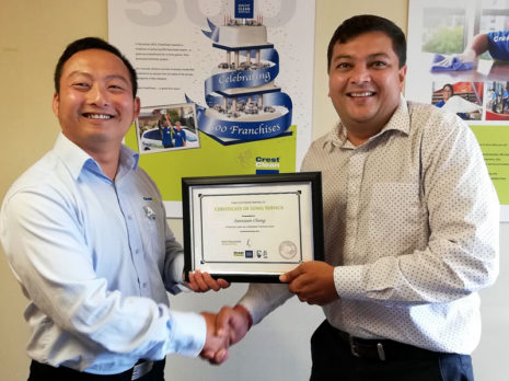 Jason Cheng receives his long service award from Nivitesh Kumar, CrestClean's Waikato Regional Manager.