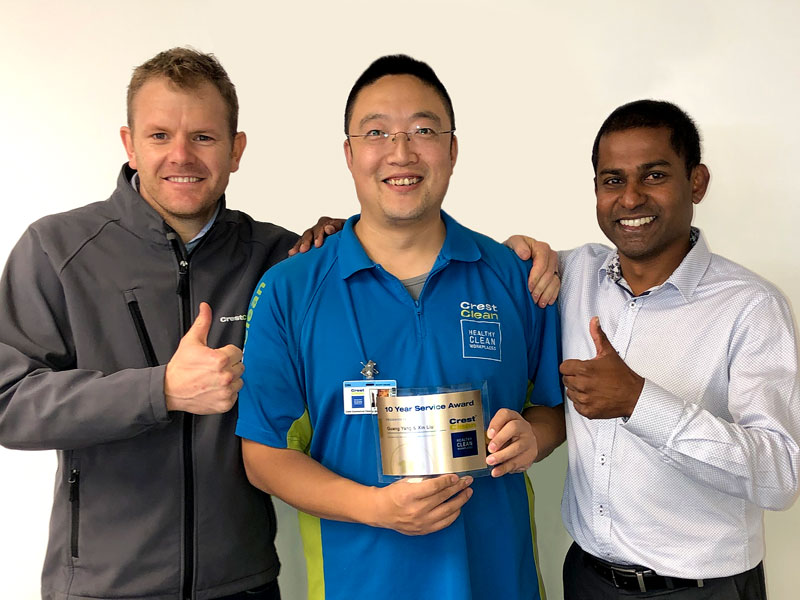 Sunny Yang receives his 10-year award from Sam Lewis (left), CrestClean's General Manager Franchise Services, and CrestClean's Christchurch North Regional Manager Yasa Panagoda.