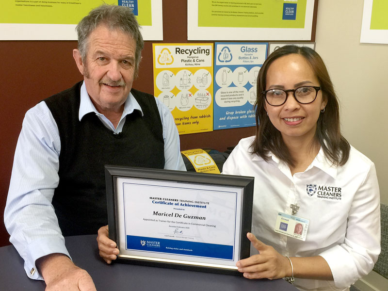 Maricel DeGuzman receives her Certificate of Achievement from CrestClean's Invercargill Regional Manager Glenn Cockroft.