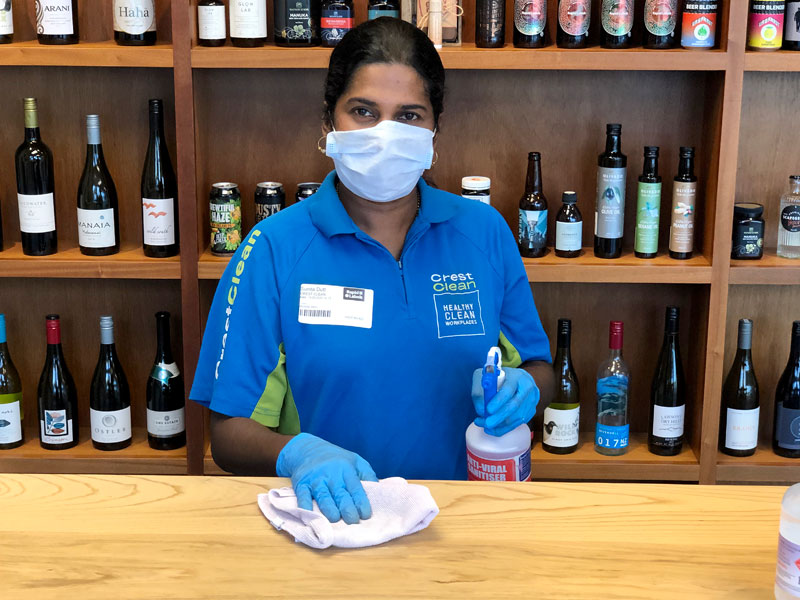 Sunita's focus is to clean and apply an anti-viral sanitiser to high-touch surfaces.