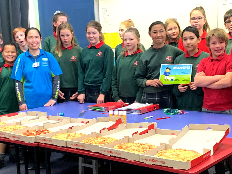 Joy Pombo is popular with students as she hands out pizza at Ashburton Intermediate School.