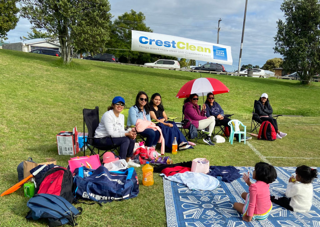 Families watching cricket.