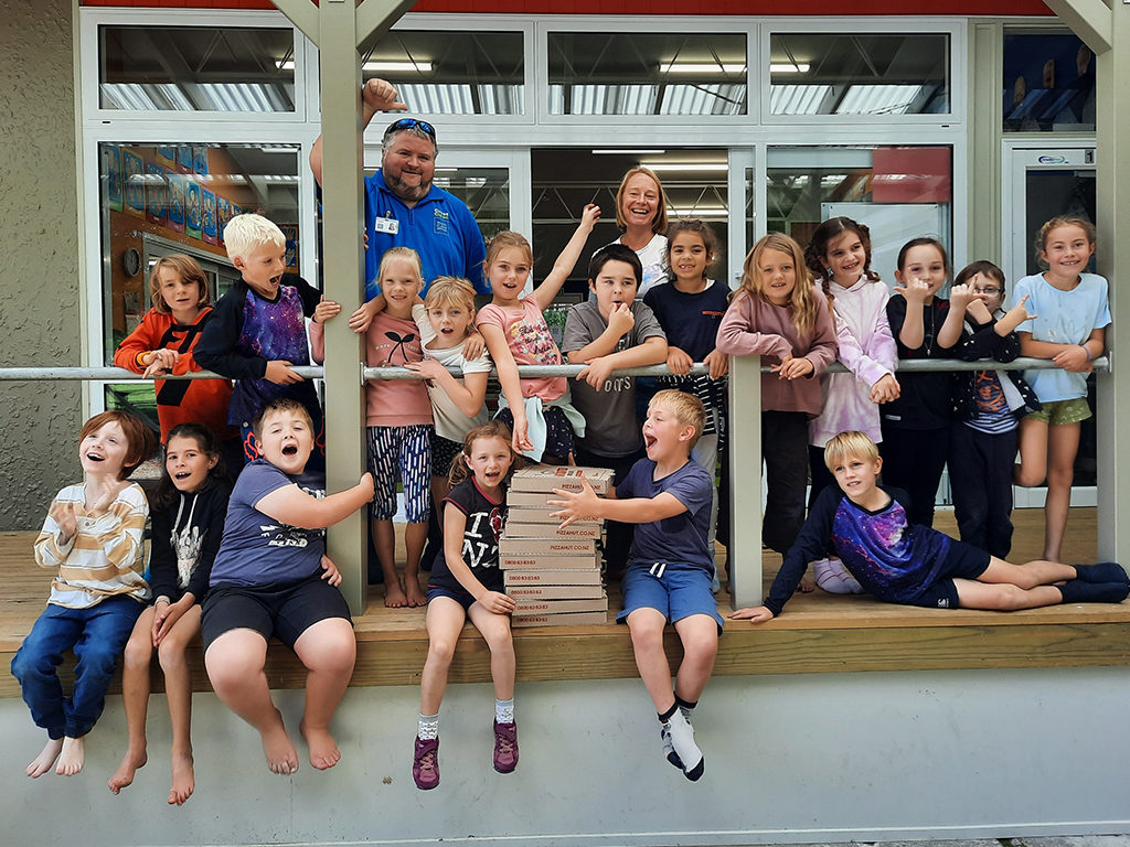 Pupils celebrate award with pizza.