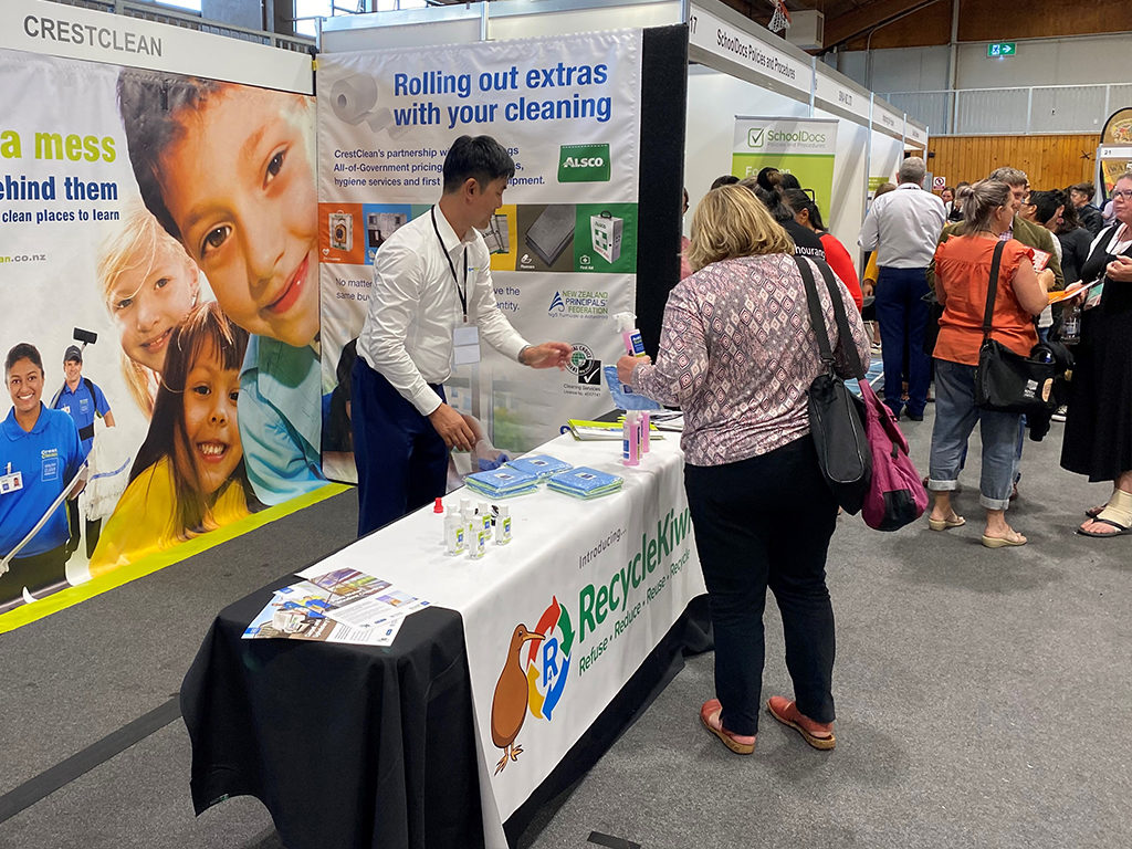 Cleaning stand at education conference.