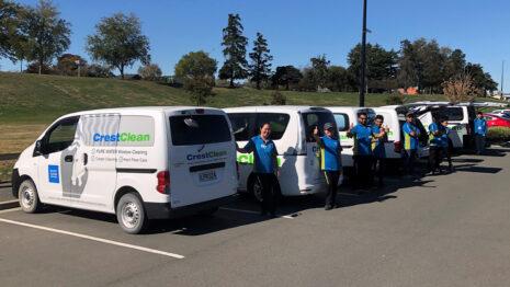 Cleaners by their van.