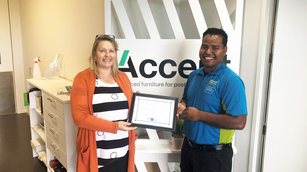 Cleaner is presented with long service award.