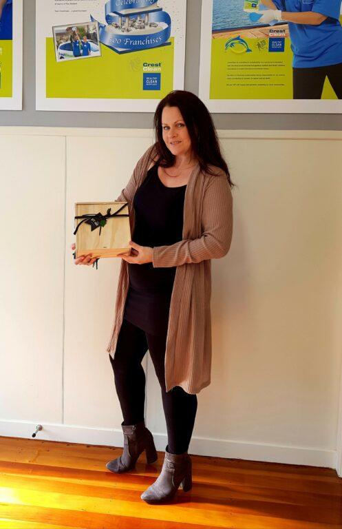 Woman holding gift hamper.