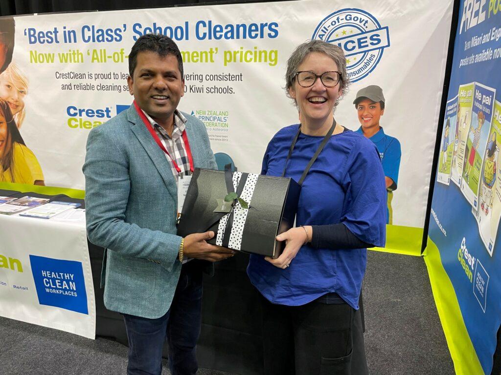 Gift hamper winning receiving prize.