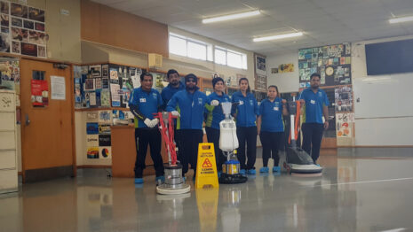 Cleaners with their floor cleaning machines.